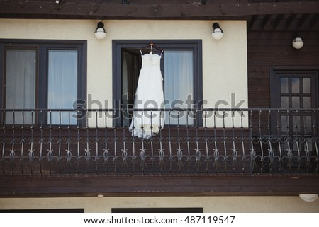 Wedding dress hanging on a shoulders
