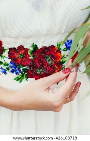 wedding dress in Ukrainian style - stock photo