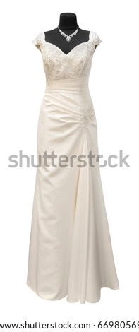 wedding dress on a mannequin on a white background - stock photo