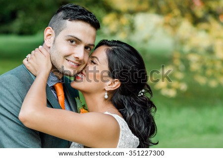 Wedding/engagement. Couple kissing in the park.  - stock photo