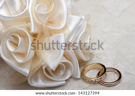 wedding favors and wedding ring on on colored background - stock photo