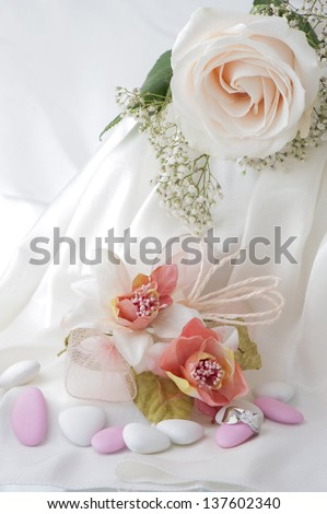 Wedding favors,wedding rings and flowers on white background - stock photo