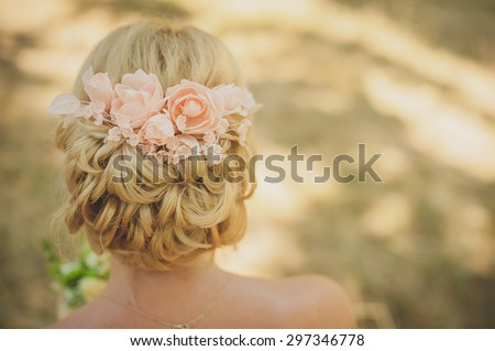 wedding, flower decorations in the hair of the bride - stock photo