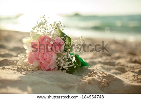 Wedding flowers bouquet on the beach  - stock photo
