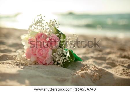 Wedding flowers bouquet on the beach  - stock photo