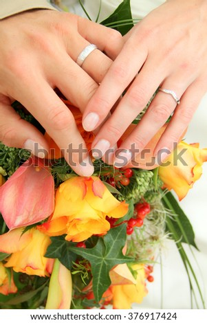 wedding flowers, hands and rings