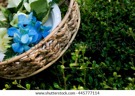 Wedding flowers in a basket. - stock photo