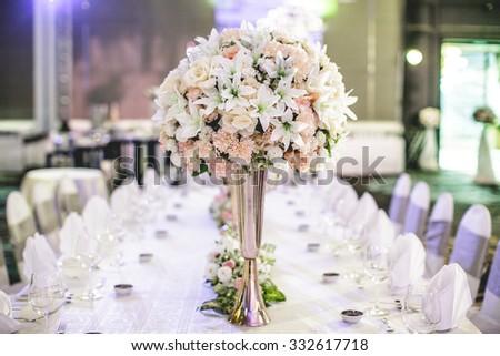 Wedding flowers on table dinner - stock photo