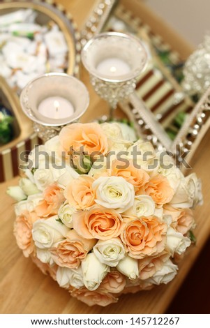 Wedding Flowers On Wooden Table