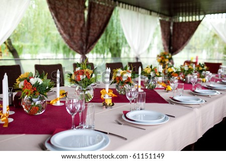 Wedding flowers - tables set for wedding - stock photo