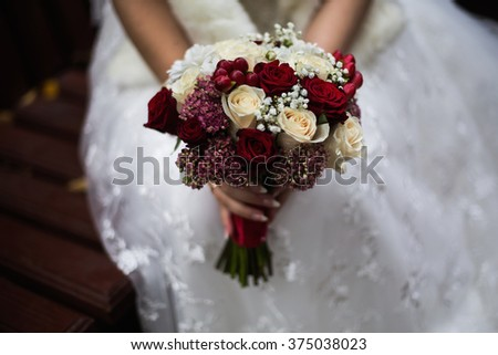 wedding flowers, wedding bouquet, the bride holding a bouquet of red and peach, dairy roses and white flowers, wedding ceremony