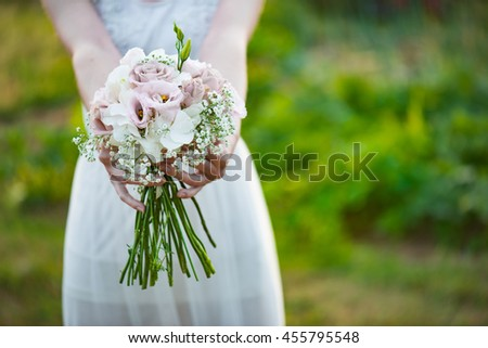 Wedding flowers ,Woman holding colorful bouquet with her hands on wedding day - stock photo