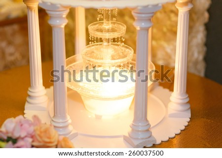 wedding fountain with candles - stock photo