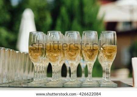Wedding glasses filled with champagne at the banquet