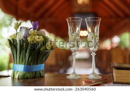 wedding glasses of champagne and bouquet of beautiful flowers: eustoma, Muscari, Crocus - stock photo