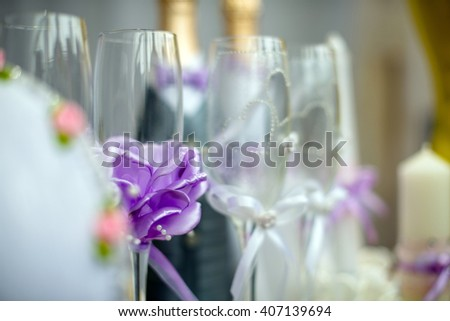 Wedding glasses with purple accessory  - stock photo