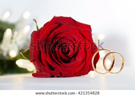 wedding gold ring with diamond and rose flowers - stock photo