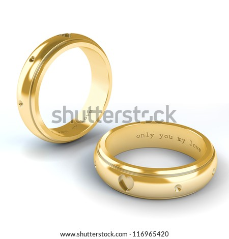 Wedding gold rings isolated on white background