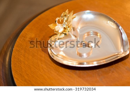 wedding gold rings laying on the gold plate