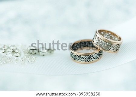 Wedding gold rings on white ribbon