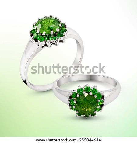 Wedding green gem Ring on abstract blur background - stock photo