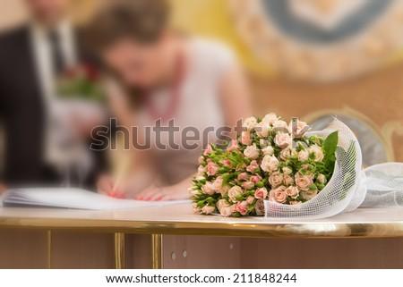 wedding groom bride bouquet rose - stock photo
