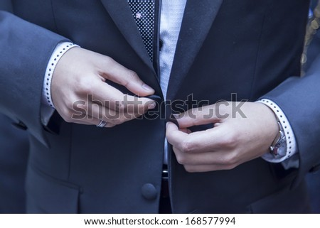 wedding groom getting ready in suit - stock photo
