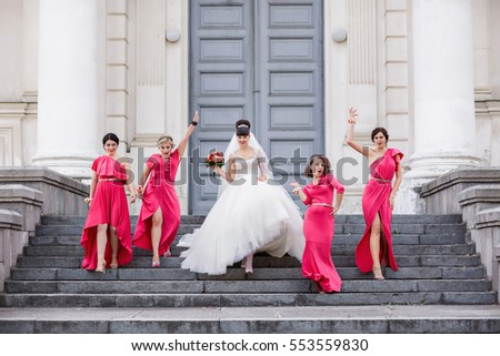 Wedding guests, bride and bridesmaids going to place of wedding ceremony