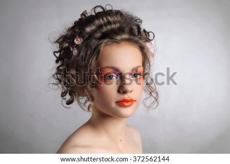 Wedding hairstyle. Close-up portrait of beautiful girl.