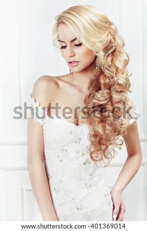 Wedding hairstyle. Portrait of the bride. Long blonde hair, the curls. - stock photo
