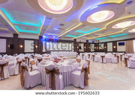 Wedding Hall Or Other Function Facility With Colorful Ceiling Lights Set For Fine Dining