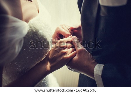 wedding hand holding. - stock photo