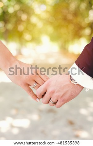 Wedding Hands With Rings In Sunlight