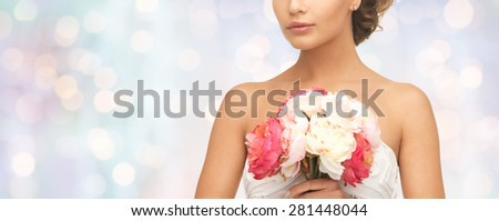 wedding, holidays, people and celebration concept- bride or woman with bouquet of flowers over blue holidays lights background - stock photo