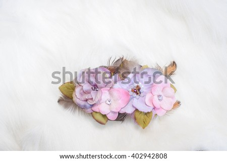 Wedding Hydrangea Hair Accessories (Artificial Pink and Purple Hydrangea Flowers made from Cloth Fabric), isolated on the white fur coat - stock photo