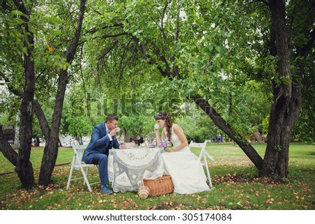 wedding in apple orchard - stock photo