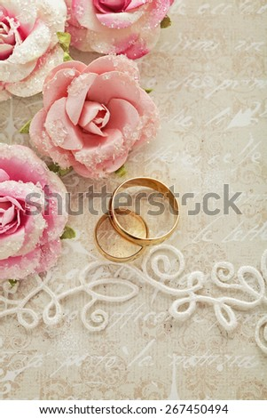wedding invitation with flowers and wedding rings - stock photo