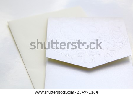 wedding invite and card over a white background - stock photo