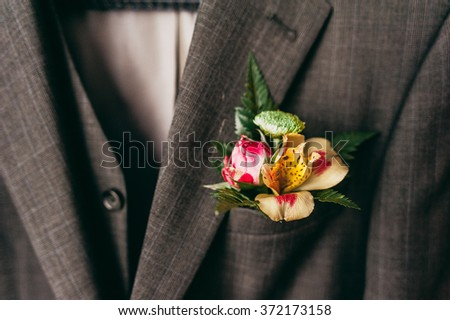 Wedding jacket with wedding boutonniere