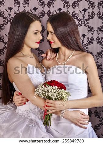 Wedding lesbians girl in bridal dress. Wallpaper background. - stock photo