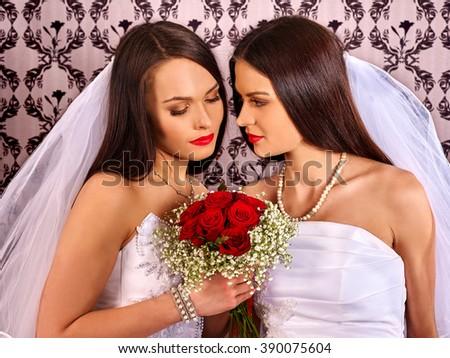 Wedding lesbians girl in bridal dress. Wallpaper background. Alternative wedding. - stock photo