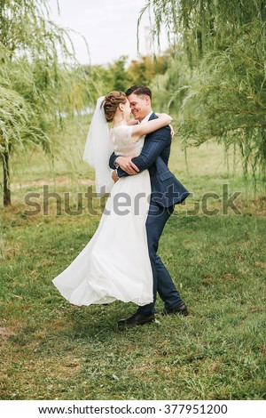 stock photo wedding love relationships marriage happy married couple dancing on nature among willow trees 377951200