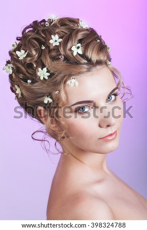 Wedding make up and hairstyle with flowers - stock photo