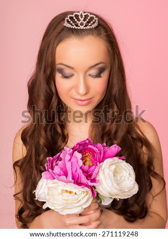 wedding makeup. Portrait of a bride on a pink background - stock photo