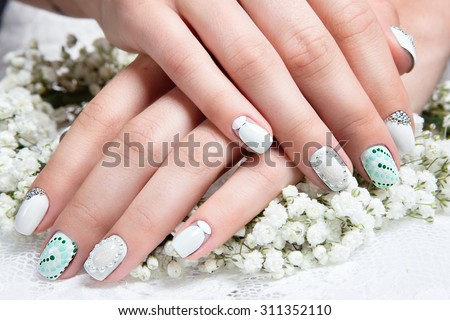 Wedding manicure for the bride in gentle tones with flowers. Nail Design.  - stock photo