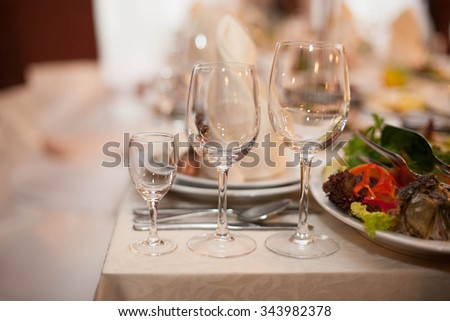 Wedding nicely decorated table serving glasses and cutlery