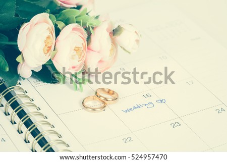 Wedding note on a calendar sets a reminder for the wedding day
