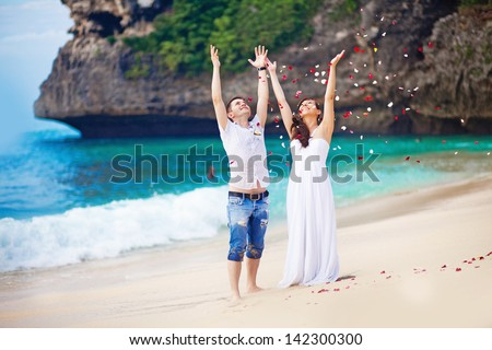 wedding on the beach with flower petals