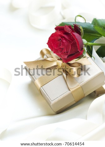 Wedding or Valentine gift over white silk - stock photo