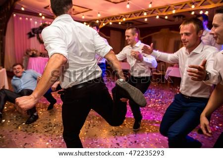 Wedding party groomsmen having fun dancing stock photo image wedding party groomsmen having fun and dancing at wedding banquet selective focus junglespirit Image collections